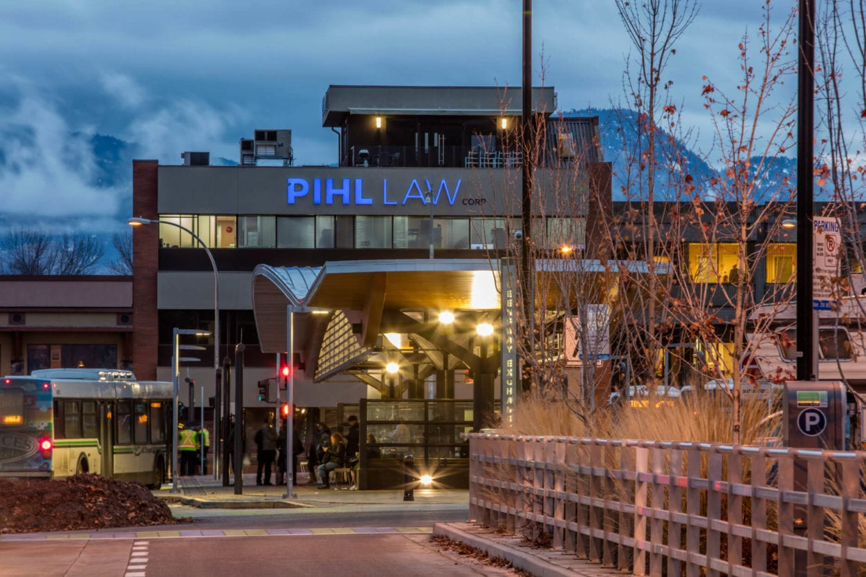 Pihl Law Office Building from Queensway Bus Station at dusk with light flare