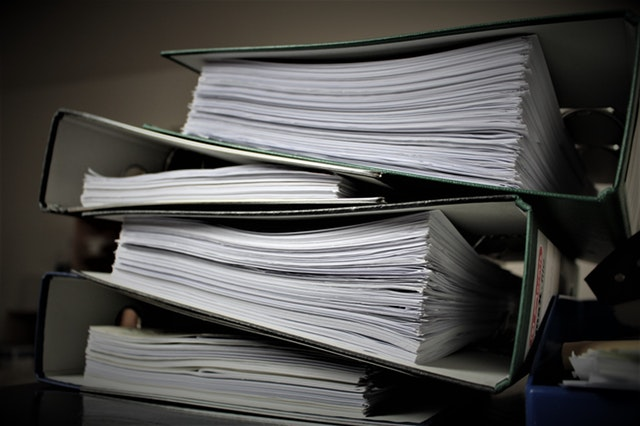 Stack of Binders highlighting the litigation process