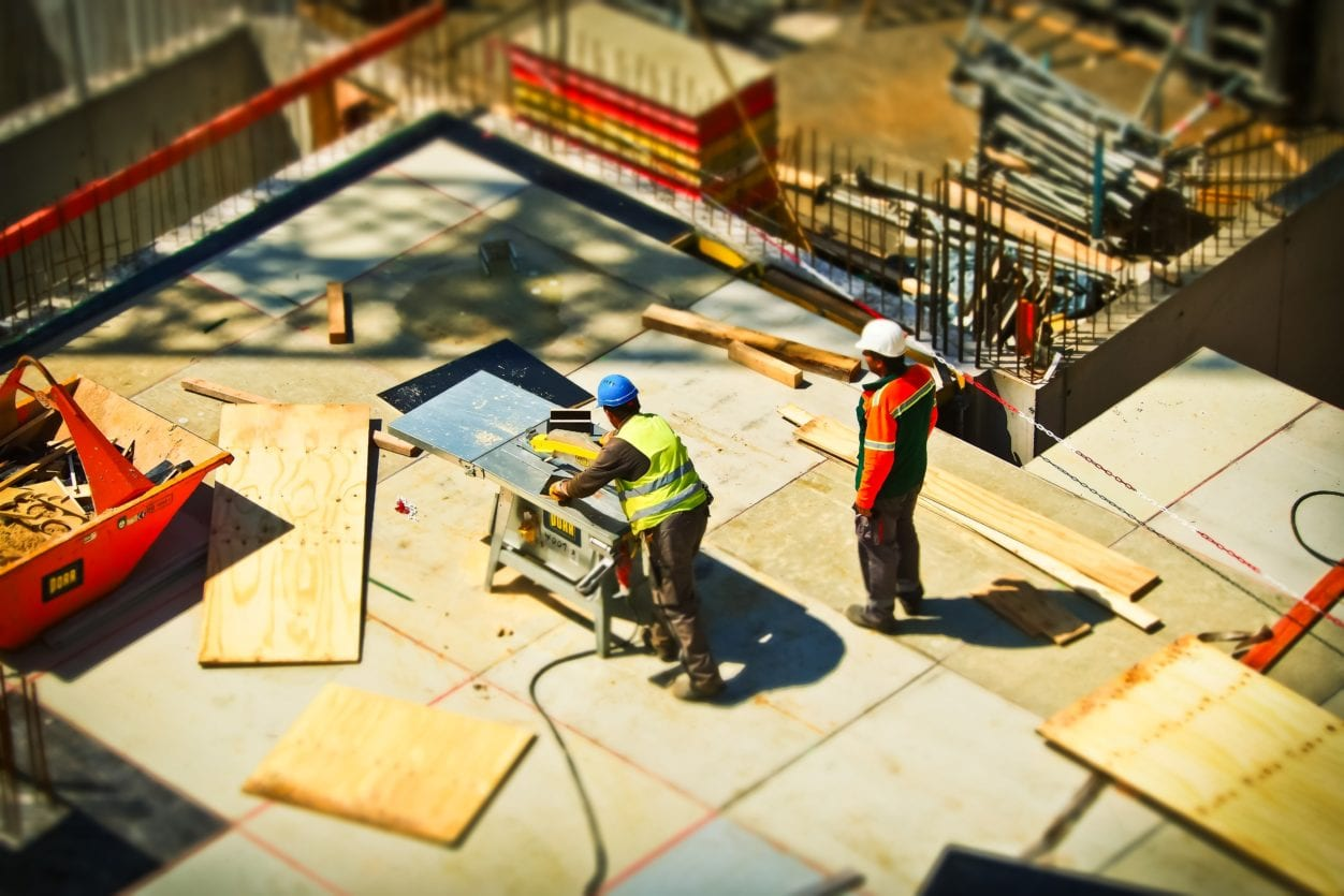 Construction workers cutting wood highlighting Builders Lien Holdbacks
