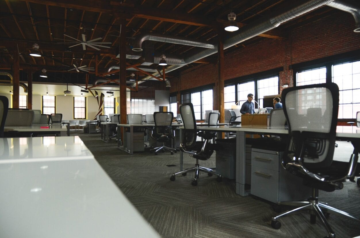 Empty work desks highlighting termination of employment